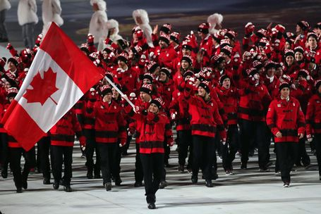 Canada's Olympic athletes 2014 - awesome uniforms!!! Hailey Wickenheiser carrying the flag!