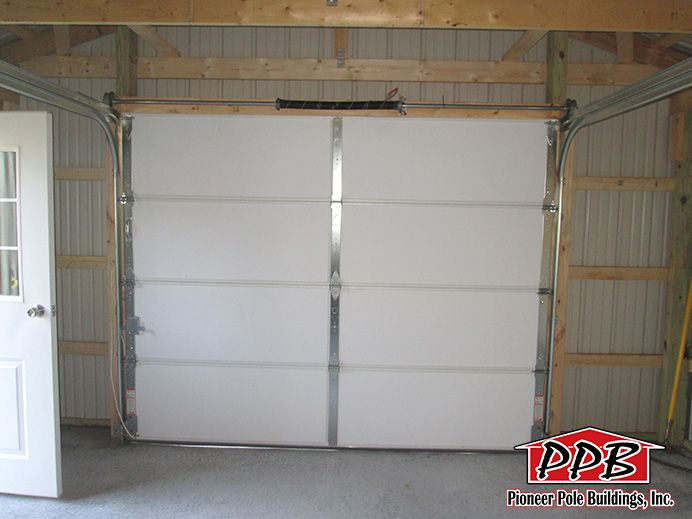Inside of 9' x 7' Residential Garage Door http://pioneerpolebuildings.com/residential/project/16-w-x-24-l-x-8-4-h-id-459-total-cost-contact-us