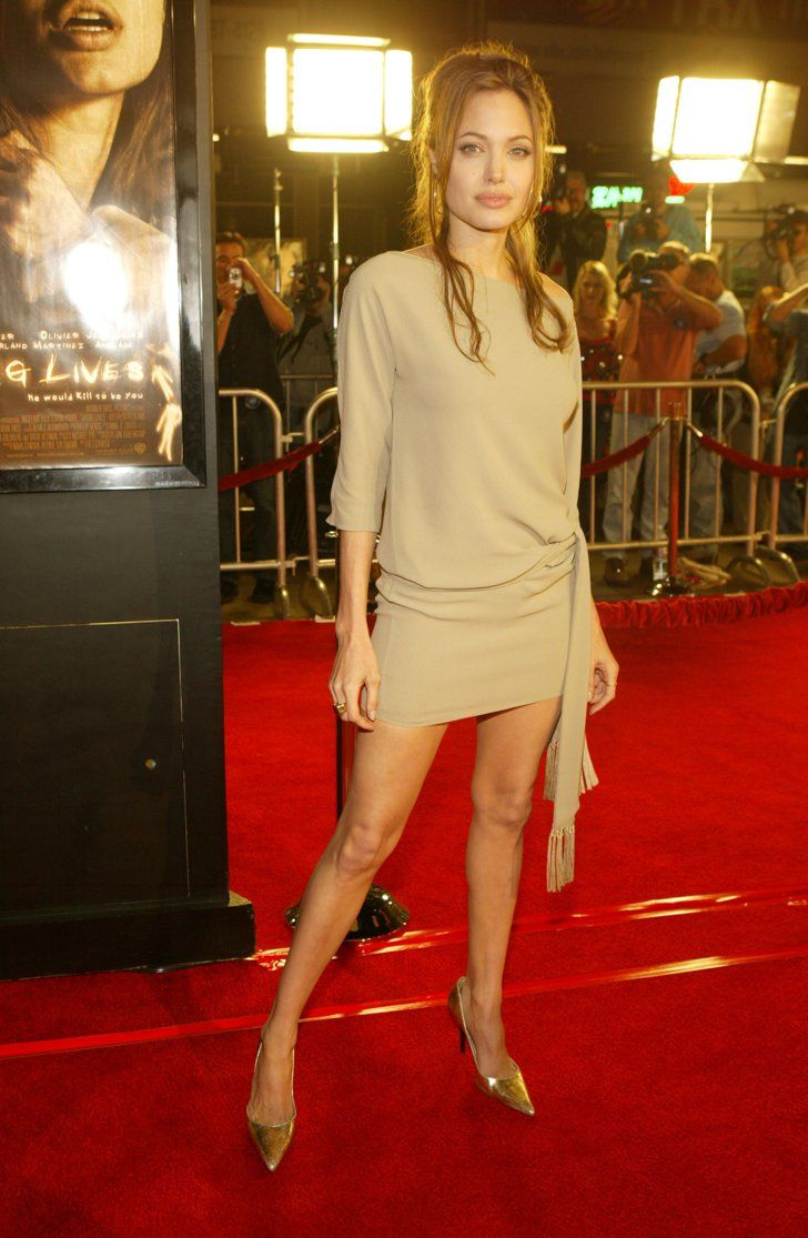 Pin for Later: 52 Reasons to Celebrate Angelina Jolie's Red Carpet Evolution Angelina Jolie's Red Carpet Transformation Angelina showed off her long, toned legs in her sand-colored Céline dress and gold Michael Kors pumps in 2004.