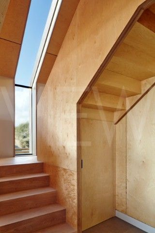 Camber Sands Beach Houses Rye United Kingdom Architect Walker and Martin 2014 View of plywood stairc