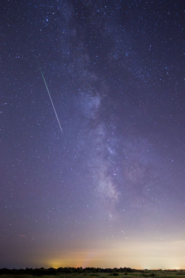 Photographer Chris Bakley captured this spectacular photo of a Perseid meteor streaking over Cape May, New Jersey during the Perseid meteor shower's peak on Aug. 12, 2015. <br />