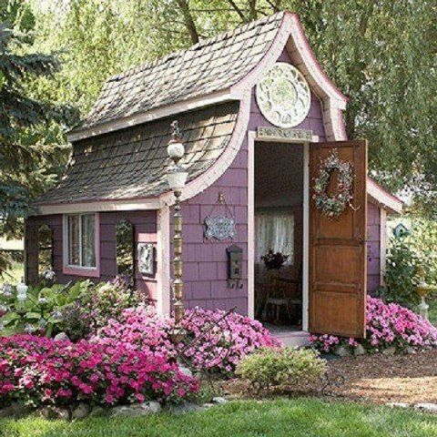 lilac colored shed with pretty flowers...