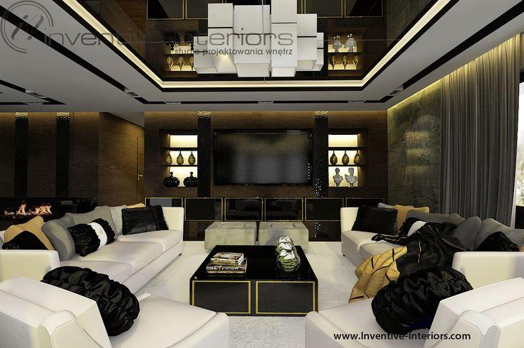 Projekt apartamentu 130m2 Inventive Interiors - ciemny nastrojowy salon - projekt ściany TV z podświetlanymi półkami - akcenty złota