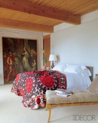 An antique suzani as a bedcover.