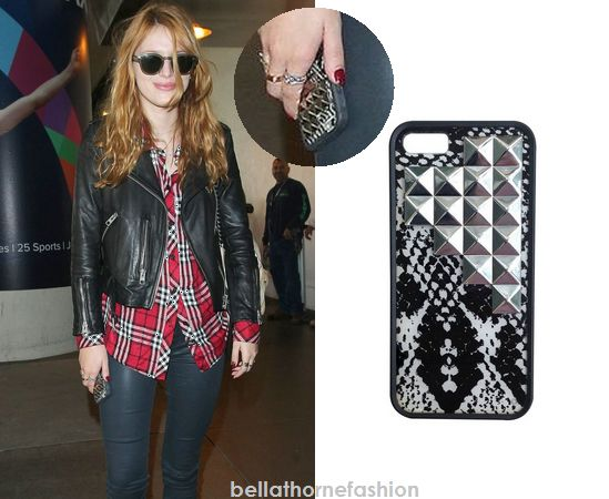 Bella Thorne uses this Wildflower Cases Snakeskin Silver Studded Pyramid iPhone Case arriving in LAX on November 12th 2014.