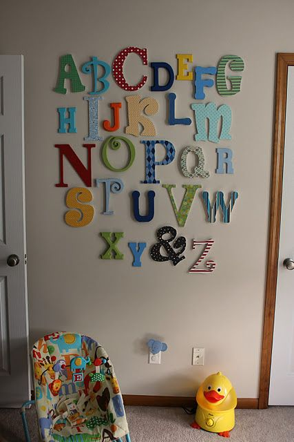 Alphabet Wall - you could use fabric or scrapbooking paper to cover the letters...