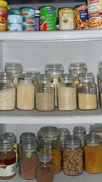 Great use for old candle jars w/air tight lids (Yankee Candles, etc.) Super organized kitchen cupboards with lots of jars