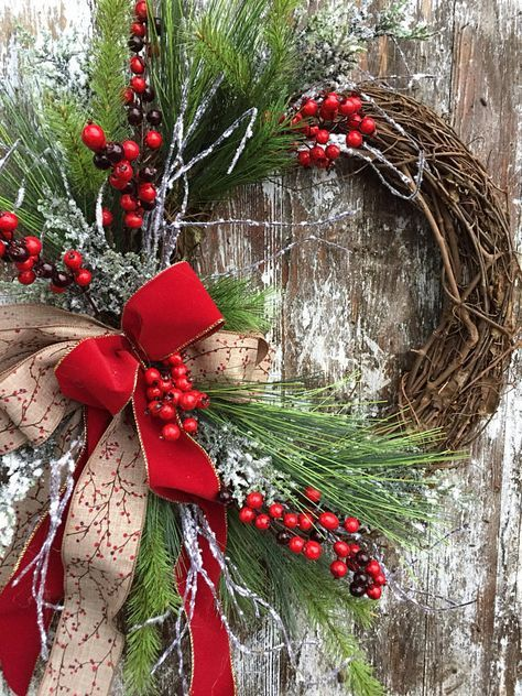 "Christmas Country Wreath - Winter Red and White Wreath - Country Wreath for Door This wreath is designed on a grapevine base with snow flocked branches, pine, and red berries. It is all complimented with a natural bow with a berry print. This wreath is approximately 24"" from top to"