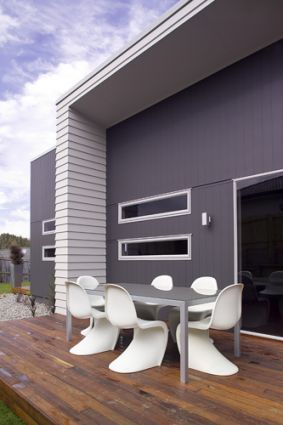James Hardie cladding product Axon™ Panel. subtle vertical lines that can be painted any colour in the spectrum, including black.