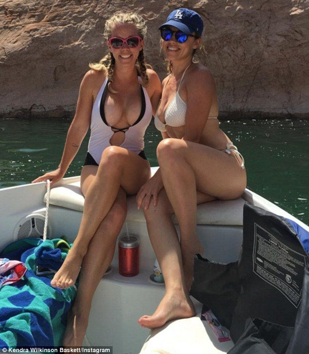 Kendra Wilkinson Shows Off Chest In Very Plunging Swimsuit