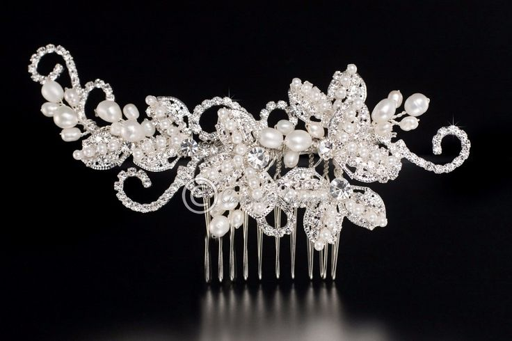 This lovely vintage-inspired bridal hair comb would be fabulous for you! A flower design is covered with ivory freshwater pearls and crystal clear rhinestones! Very detailed! It is 4 inches long and 1