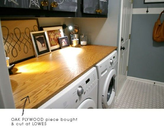 Easy and cheap! Plywood as a laundry room countertop. Lowes will cut to size... just rub on some danish oil. (add a cheap rubber floor matt between the wood and metal to dampin the sound.) - Click image to find more DIY & Crafts Pinterest pins - love this idea