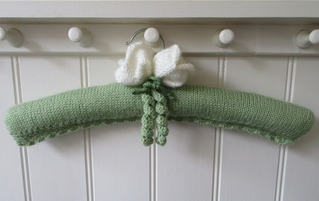 Hand knitted ladies coat hanger with white tulips £14.00