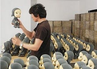 Nara Yoshitomo inspected his art toy.