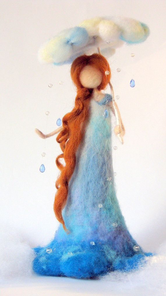 Lovely rain fairy. Needle felted art doll. Waldorf inspired- without details of her face. Nature table decoration. Tall about 10.5 You are welcome to my shop to see more of my fairies and dolls. Thank you for your visit. Original Design by Zuzana Hochman Needle felted Art doll