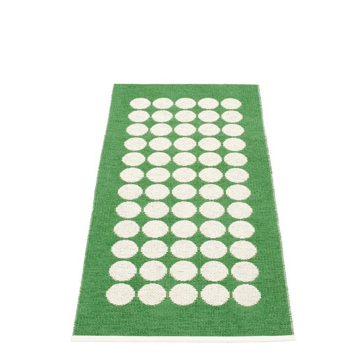 Simple circles in Pappelina vanilla adourn this lovely little rug and sit on a background of fresh and zingy Pappelina colours. There are 12 colours in all to choose from and 3 sizes of runner, the smallest will be perfect as a bath mat.  Coolest and most practical plastic mats, great for allergies as they are washable too!