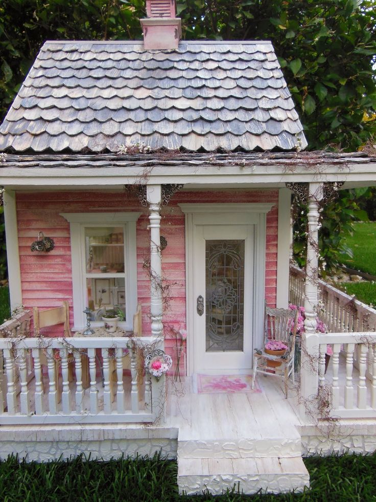 dollhouse cottage.  I love the little stuff growing out of the rain gutters.