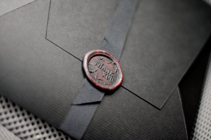 Found on Weddingbee.com Wax embossed ribbon seal for folder. Easy DIY