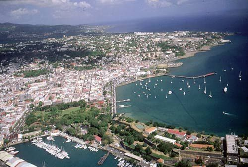 Fort-de-France, also known as the Fort of France, lies on Martinique's west coast at the northern entrance to the large Fort-de-France Bay, at the mouth of the Madame River. The city occupies a narrow plain between the hills and the sea but is accessible by road from all parts of the island.