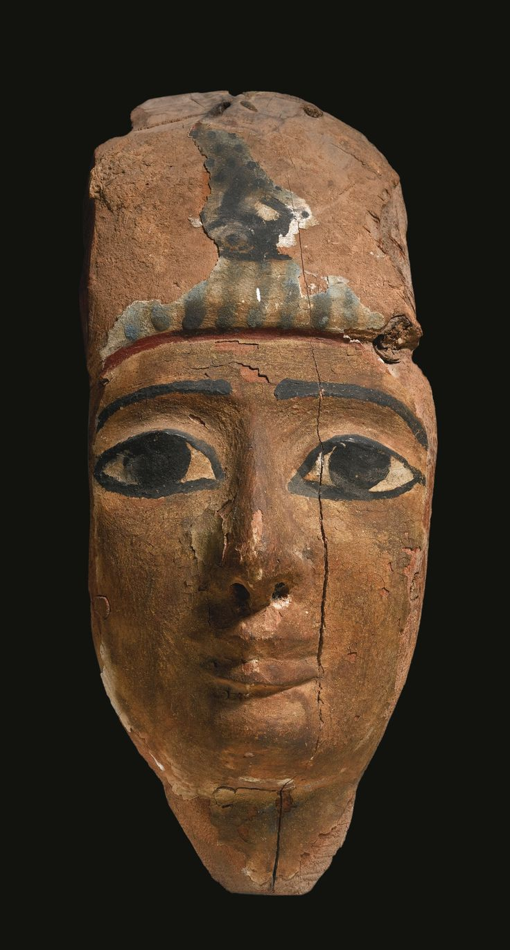 Wooden mummy mask. 3rd Intermediate Period. 1075-716 B.C. | Sotheby's