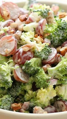 Broccoli Salad with Grapes Recipe ~ Crisp broccoli is combined with sweet juicy grapes and crunchy bits of red onion just before being tossed with a tangy sweet balsamic dressing.