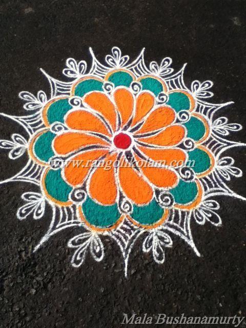 Free hand style flower kolam done by Mala Bushanamurty