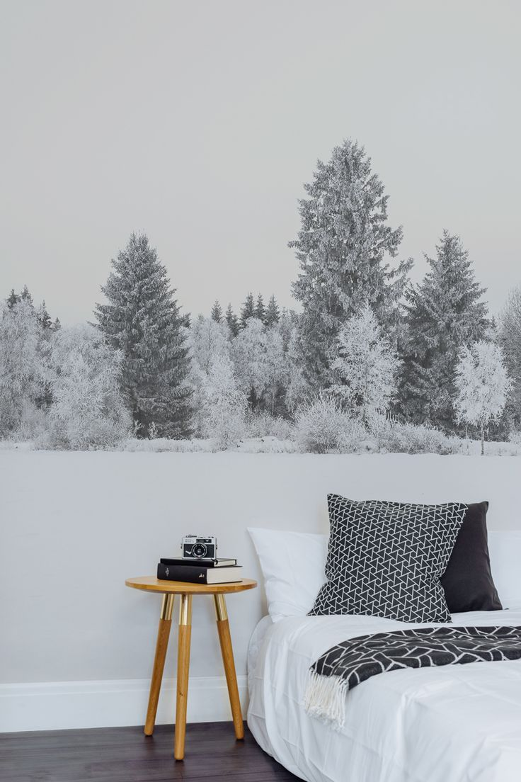 Fall asleep under this serene snowy landscape with this forest wall mural. Giving you a dreamy feature wall in your bedroom.
