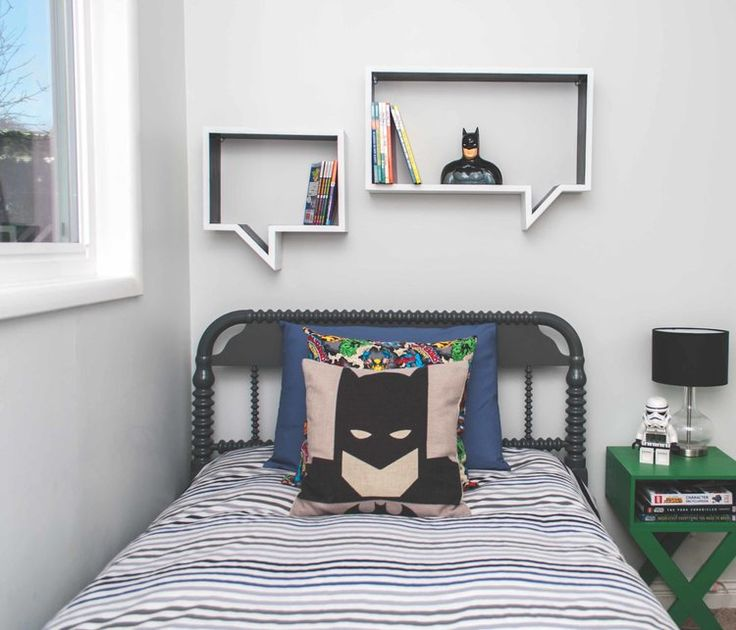 Superhero kids bedroom with speech bubble shelves and Batman pillow