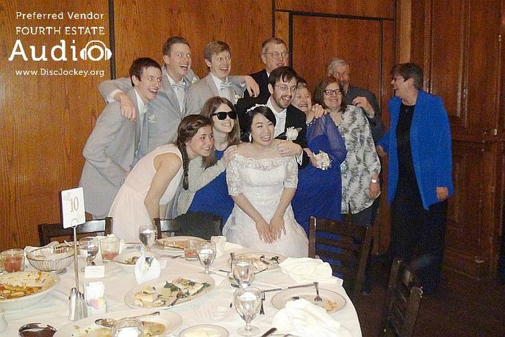A newlywed couple poses with a table full of wedding guests at Maggiano's in Schaumburg. http://www.discjockey.org/maggianos-schaumburg/