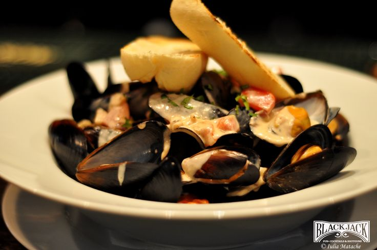 Mussels in white wine sauce, cherry tomatoes  and rozmarin