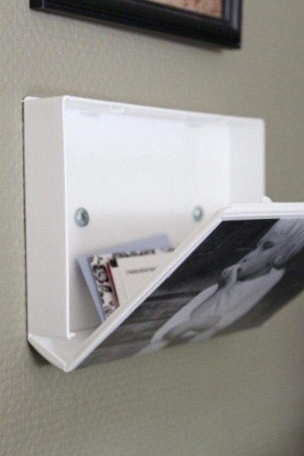 Use an old VHS cover as a picture frame with hidden storage.