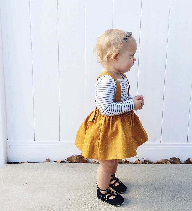 Our Andi trouser mini skirt has cute adjustable suspenders withbuttons on the back. There are two button holes on each suspender strap so your child can wear t