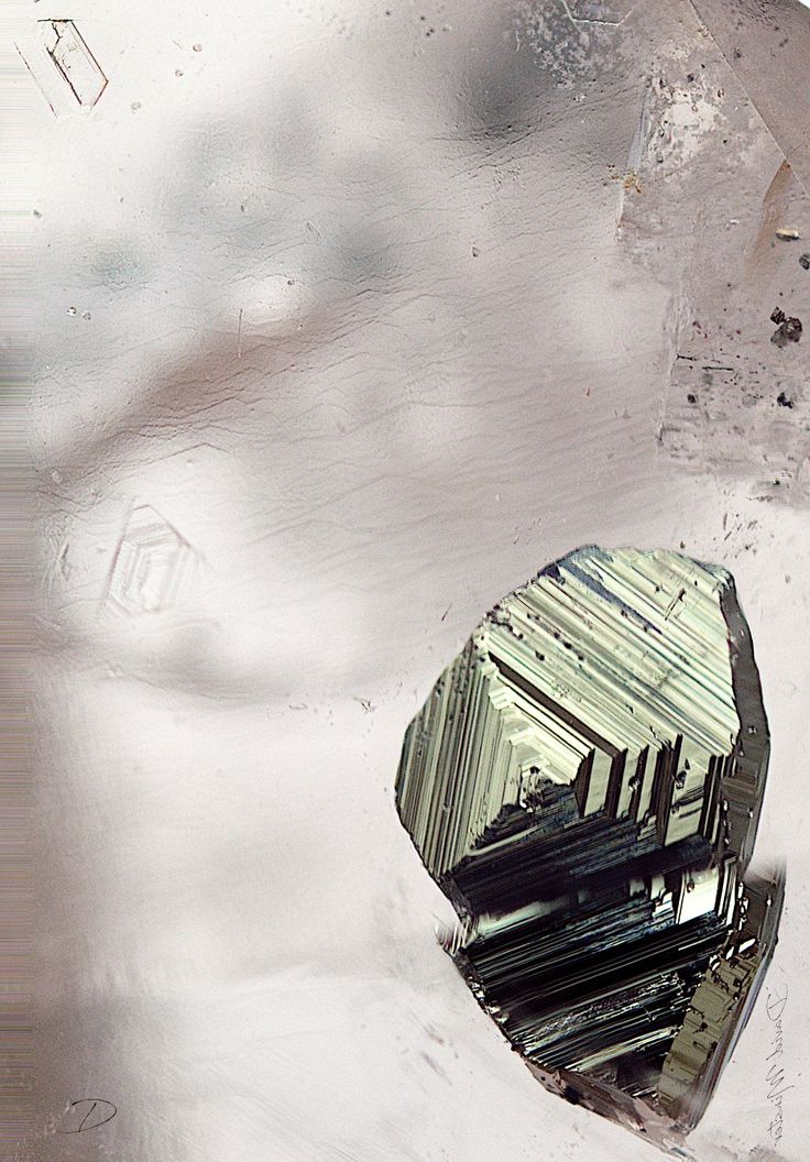 Chalcopyrite crystal in quartz, Griqualand. The crystal is 1mm long.