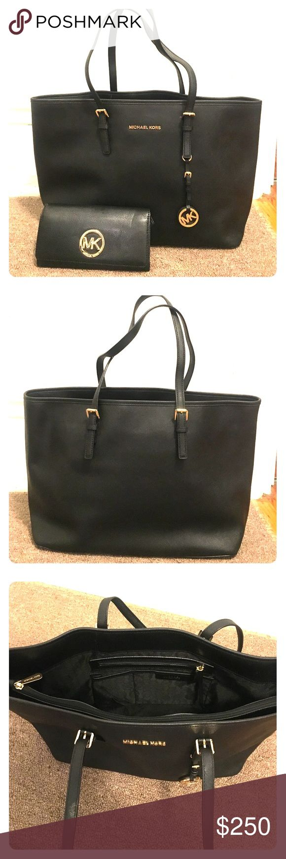 Michael Kors Jet Set Travel Med Saffiano Lthr Tote MK Jet Set Travel Medium Leather Tote with inside divider. Color- Black. Amazing Condition! Only used 2 times. Also including a MK Fulton Leather Carryall Wallet (retail price of $148.00 separate from bag price) with purchase of tote (both together would normally retail at $446 before tax). Comes with original duster bag. Michael Kors Bags Totes