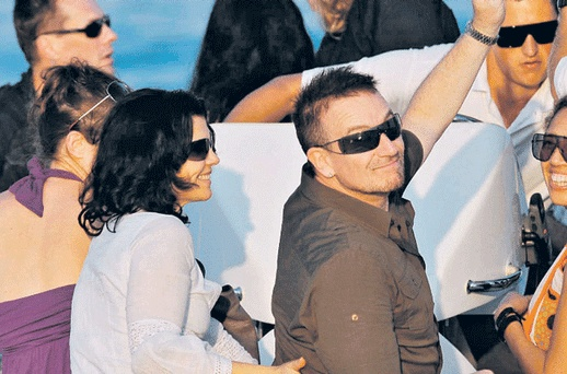 Bono & Ali Hewson leaving Club 55 in St Tropez while on holiday with  husband Bono and their tight-knit circle of friends.