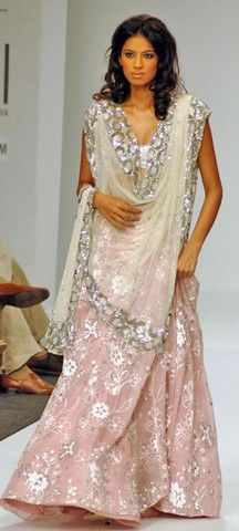 Love the mix of textures here - pink lace skirt and sequined dupatta. Designer: Swapan and Seema