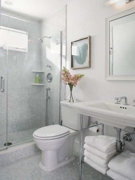 Small bathroom design, use of mosaics, light colours and glass walls