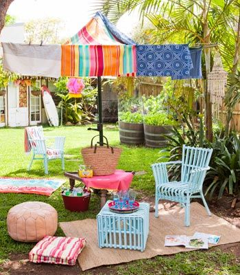 Carnival fun -- How easy it is to turn a typical backyard into a beach-style retreat — careful, you may never want to move out of the garden! We've thrown assorted colourful textiles over the clothesline to create a gorgeous tent-like affair. Mix up the patterns for visual interest. The Hills Hoist has never looked so good! Not only is our glorious tent perfect for shade, but it becomes a space for kids' imaginative play.