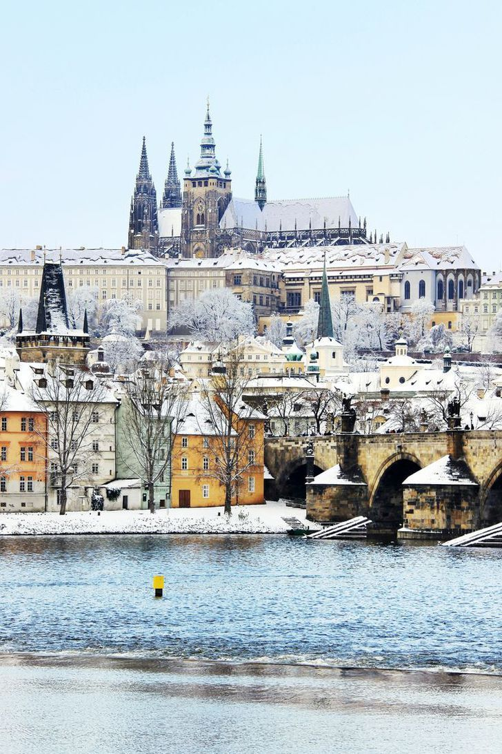 Snowy Prague gothic Castle with the Charles