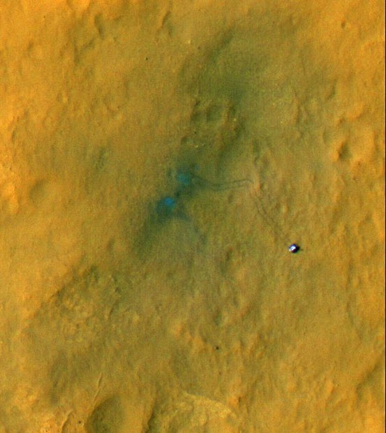Tracks from Curiosity are visible in this image captured by HiRISE. The rover is seen where the tracks end. The image's colour has been enhanced to show the surface details better. The two marks seen near the site where the rover landed formed when dust was blown away by the rover's descent stage. [Picture: EPA/NASA/JPL-Caltech/Univ. of Arizona}