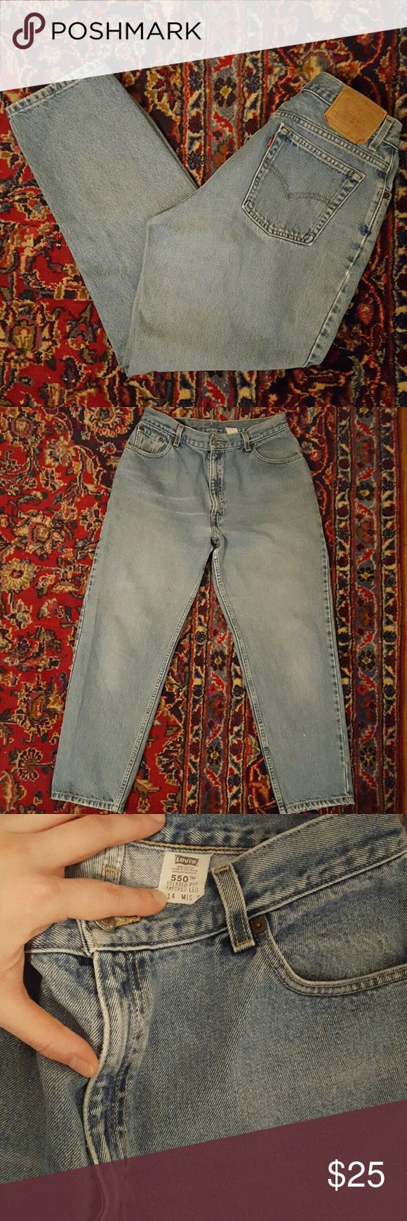 """Vintage Levi's 550 High Waisted Jeans 31"""" Vintage high waisted  Levi's with a 12"""" inseam, great condition with light distressing. Marked size 14, but more of a modern size 12. Levi's tag is loose. Levi's Jeans"""