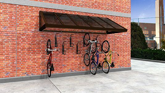 Annex is a slim profile, wall mounted bike shelter that provides covered bike parking without the need for a concrete foundation where space and budget are limited.