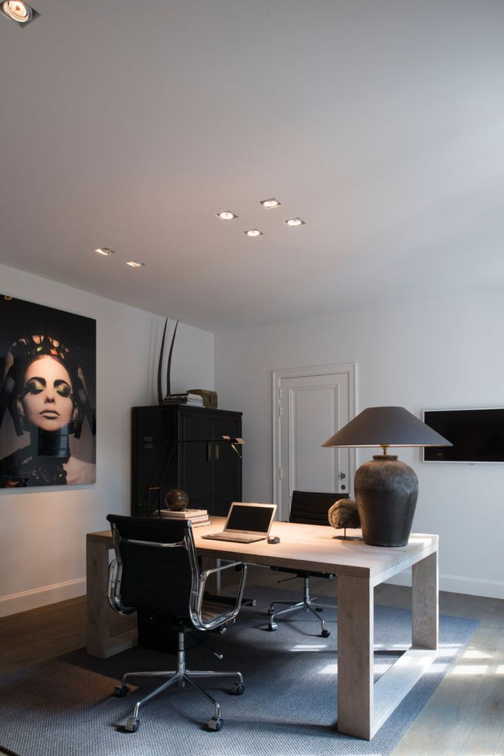 I like the idea of a desk in the middle of the room. Classy photo art too