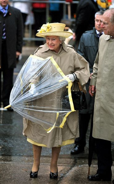 Queen Elizabeth II - the Queen has her transparent umberellas colour co-ordinated to her outfits