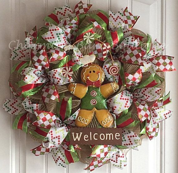 The colorful gingerbread man welcome wreath will be a great addition to your holiday decor. So cute! Made with natural colored deco mesh and