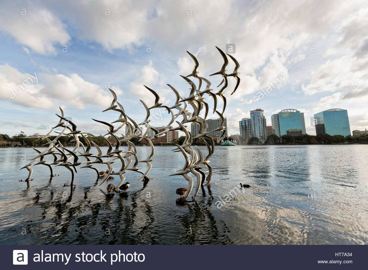 Sculpture Take Flight by artist Douwe Blumberg on Lake Eola in Orlando, Florida. Lake Eola Park is located in the heart of Downtown Orlando and home to the Walt Disney Amphitheater. Stock Photo