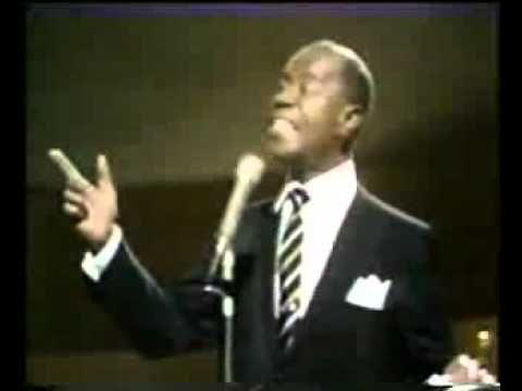 Louis Armstrong - It's a Wonderful World My granddaughters used to sing this in the morning while I fixed their hair for school, great memories