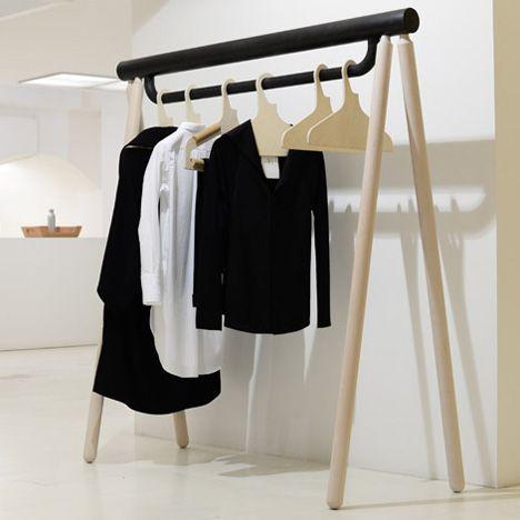 Japanese fashion designer Yohji Yamamoto presented his Spring/Summer 2014 collection on chunky wooden garment rails by product designer Torsten Neeland.