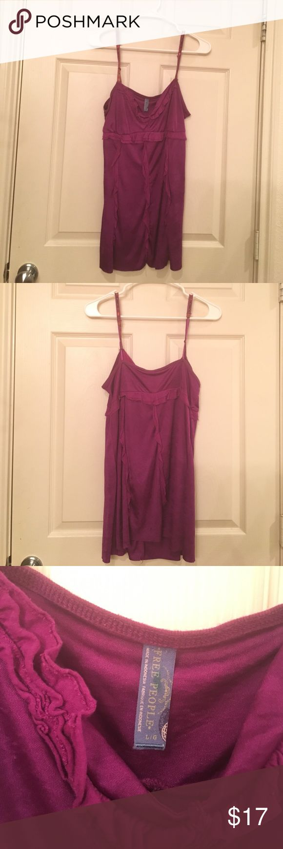 Ruffle tank Beautiful color, cute flower strap detail perfect dressy tank for summer. Free People Tops Tank Tops