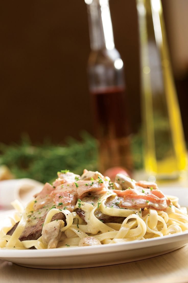Saltimbocca. Fillet medallions, sautéed in herbed olive oil, served on a bed of fettuccini layered with mozzarella cheese and finished with crispy bacon, ham and sliced mushrooms in a rich, cream-based sauce | Panarottis http://www.panarottis.co.za/ourmenu/pastas